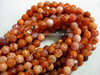 FIRE AGATE 6MM FACETED ROUND BEADS