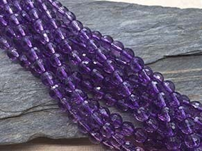 amethyst 6mm E faceted ball strands